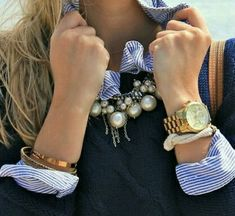 Preppy navy crew neck sweater, stripe blouse accented w/ collar of pearls & bling. Love this look!
