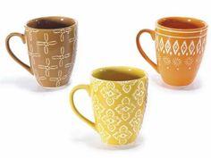 Tazza in ceramica colorata con decoro in rilievo  Ø 7,1 cm x 8,4 H Capacità: 170 ml