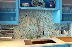 Climbing Vine mosaic from New Ravenna. LOVE with the blue cabinets.