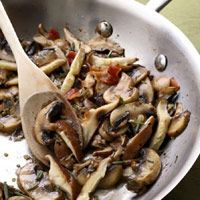 MUSHROOM SIDE: 1 ounce  bacon, (about 11/2 slices), chopped 1 1/2 pounds  mixed mushrooms, such as cremini, shiitake (stemmed) and portobello, cut into 1/4-inch slices 2 medium  cloves garlic, finely chopped 1 1/2 teaspoons  chopped fresh rosemary, or 1/2 teaspoon dried 1/4 teaspoon  salt   Freshly ground pepper to taste 1/4 cup  dry white wine
