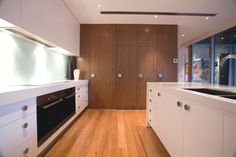 our light kitchen floor contrasted by teak and white kitchen cabinets?