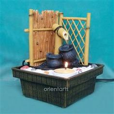 Bamboo Fence Zen Garden Water Fountain: The zen garden water fountain can create romantic, calmness and relaxation. It includes one rake, sand, rocks and one tea light candle. Running water with the ball create wealth too.