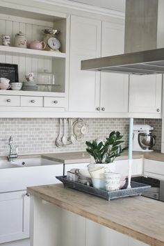 Small gray subway tile backsplash, white cabinets