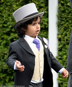 Eight-year-old Mohammed bin Ahmed Jaber Al Harbi returned to the UK for Royal Ascot & appeared clutching the hand of Sheikh Mohammed bin Rashid Al Makhtoum, the Emir of Dubai. Walking right behind him was his 'best friend', the emirate's dapper Crown Prince Hamdan, & the royal's step-mother, Princess Haya of Jordan. Mohammed is the son of Ahmed Jaber 'AJ' Al Harbi, a close friend of the Emirati prince, & spends much of his time travelling the world with his father & the royals