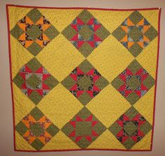INSPIRED BY ANTIQUE QUILTS had this quilt posted on her blog. QM loves this color scheme!