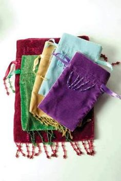 """Velvet Beaded Drawstring Pouches       A gift in itself! Present your gifts with panache...easy and elegant. 5 asst. colors. Velvet. Largest 7 x 9""""."""