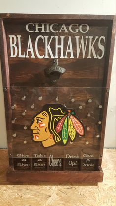 Perfect gift for a Chicago Blackhawks fan!  Add a little fun and whimsy with the drinking version of the game Plinko. This will be a great addition to your bar, game room, or man cave!  Item pictured is finished with mahogany stain and rustic bottle opener but also available in an oak, walnut and ebony finish. Chrome bottle opener also available. Choose your stain and opener preference during checkout. Made with durable plexiglass and measures approximately 21 X 13.  Two styles available…