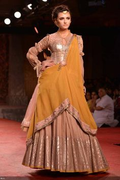 A model showcases a creation by designer Anju Modi on Day 1 of Delhi Couture Week, held in New Delhi, on July 31, 2013