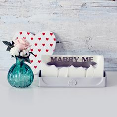 Ask her with this lovely unscented candle and she'll remember that moment forever.  The candle comes in a silicone trey and when lit, burns for about 30 minutes before the message is revealed and then the candle extinguishes and the message remains.  Each candle has been assembled and hand poured in the UK.  Candle weight: 700g  Candle plus tray size: 22cm x 7.5cm x 9.5cm