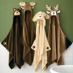 """Give your little hunter a versatile Animal Hooded Towel they can wear when they are drying off at the lake or at home. Made of 100% cotton and detailed down to the tail on the back. 53-1/2""""W x 38""""H. Available: Yellow Lab, Bear, Moose, Deer."""