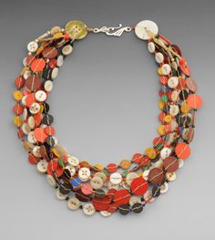Necklace | Chloe French.  Old Buttons, vintage 'Vulcanic' African Trade beads (slices), and seed beads.