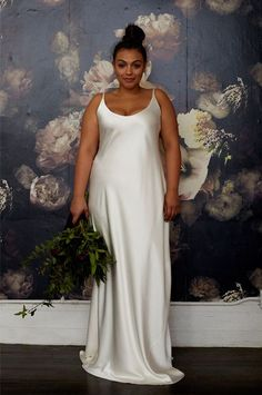 Curvy Girls, Listen Up: We've Found Your Dream Wedding Dress #refinery29  http://www.refinery29.com/plus-size-wedding-dress#slide-11  Minimal design, maximum style. Eloquii for Stone Fox Bride The Lucinda Gown, $4,800, available at Stone Fox Bride....