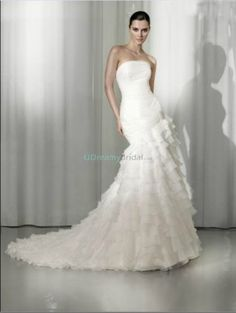 Elegant wedding dress with mermaid trumpet silhouette and strapless neckline. Features multi-layer of chiffon skirt. Free made-to-measurement service for any size. Available colors seen as in Color Options.