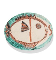 Poisson de profil Pablo Picasso (1881-1973) Poisson de profil stamped 'Madoura Plein Feu / Empreinte Originale de Picasso' (underneath) white earthenware ceramic plate with coloured engobe and glaze Diameter: 12 ¾ in. (32.3 cm.) Conceived in 1951; this work is a unique variant (see A.R. 129-132)