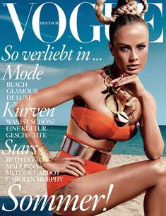 Beach Glamour – Supermodel Carolyn Murphy makes an outstanding vision in an orange swimsuit for the June cover of Vogue Germany. Carolyn poses for Alexi Lubomirski's lens.