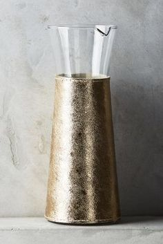 Anthropologie Leather-Wrapped Carafe https://www.anthropologie.com/shop/leather-wrapped-carafe?cm_mmc=userselection-_-product-_-share-_-C40516841