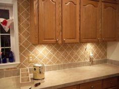 Painted faux tile backsplash