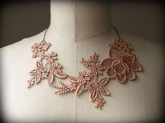BEAUTIFUL lace fabric necklace, via Etsy.