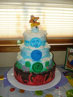 Avatar: the Last Airbender Cake:  Air, Water, Earth, and Fire symbols on a 4 layer cake.