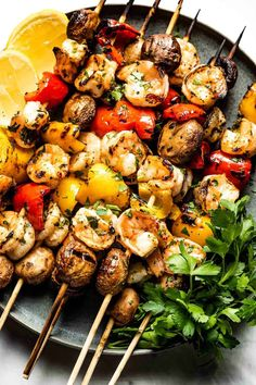Grilled Shrimp Kabobs with Vegetables for your summer grilling. Marinated in a garlicky lemon sauce and threaded along with mushrooms and peppers, these kabobs are the best. Grilled Shrimp Kabobs, Shrimp Marinade, Shrimp Skewers, Healthy Coleslaw, Shrimp And Vegetables, Stuffed Mushrooms, Stuffed Peppers, Lemon Sauce