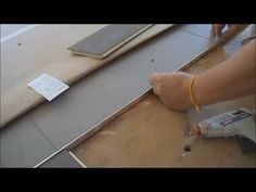 Metal Transition Strip between Hardwood Flooring and Tile: How to Install - YouTube