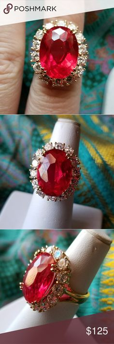 Vintage Red stone cocktail ring by Uncas size 6 This gorgeous vintage cocktail ring has a huge glittery ruby red man made gem surrounded by sparkly clear stones. Size 6. The gems are set in solid Sterling Silver with a gold overlay. The ring is signed inside 925 and the makers mark of Uncas, Thailand. It is in very nice condition with some minor surface wear. Wingi8825red9v7f Vintage Jewelry Rings