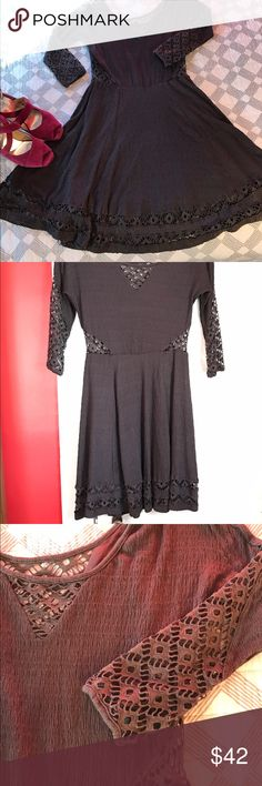"""Beautiful gray fit and flare Free People dress Wonderful, swingy skirt on this beautiful fit and flare dress from Free People. Lacy cut-work detail at the shoulders, sleeves, sides of waist, and double layered hemline. In excellent condition. Fully lined. Measurements lying flat: bust 18"""", waist 13&1/2"""", hips free. Length from shoulder to hem: 36"""". Rayon, poly, spandex blend. Free People Dresses"""