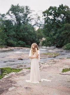 Draped short sleeved wedding gown by Carol Hannah  Autumn Wedding Inspiration at the Mill at Fine Creek by Richmond Virginia Wedding Planner East Made Event Company and Michael and Carina Photography featured on Style Me Pretty