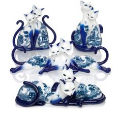 A FIRST! Limited-edition fine porcelain figurines of cat lovers inspired by the Blue Willow china pattern and finished with a high-gloss glaze.