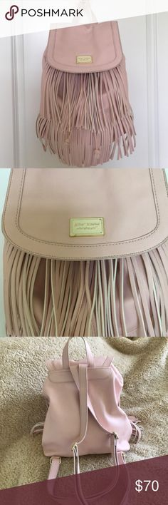 """Betsey Johnson backpack purse Betsey Johnson backpack purse. Excellent like new condition. Measures approximately 14"""" wide and 16"""" .  Great fringe detail. Drawstring top with snap closure on upper flap. Adjustable shoulder straps.  Body is 100% PVC. Lining is 100% polyester. Betsey Johnson Bags Backpacks"""