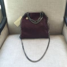Stella McCartney Mini Falabella Crossbody NWT Gorgeous Falabella mini shaggy deer tote in Plum (burgundy) with gunmetal silver chains/hardware.  Had chain handles so can be worn as a wrist bag, but also has a long strap to allow you to wear it as a crossbody.  Super room inside, enough to carry a large wallet, keys, phone & more!  Tag still attached.  Comes with dust bag. Currently retails for $1,055 + tax at Nordstroms! Get it here & avoid paying nearly $100 in tax! Stella McCartney Bags…