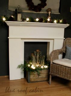blue roof cabin faux fireplace mantle and logs Faux Foyer, Faux Mantle, Faux Fireplace Insert, Fireplace Inserts, Christmas Fireplace, Christmas Mantels, Christmas Diy, Simple Christmas, Country Christmas
