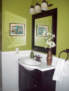 green and brown bathroom.. maybe green just behind mirror