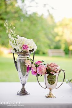 Vintage wedding decor - at the reception, I used sustainable Antique and vintage loving cup trophies filled with flowers from Geranium Lake Flowers