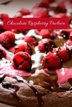 Chocolate Raspberry Pavlova (THM S, Low Carb, Sugar Free) This Pavlova is rich and chocolately with raspberry curd, fresh raspberries and handy chocolate sauce.