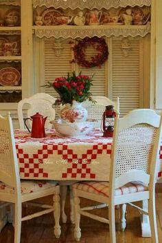 kitchen decorated red and white. Love the quilt used as a tablecloth...so county !