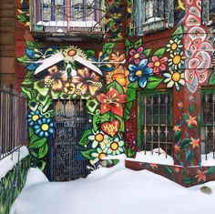 Street art meets the house on this little gingerbread facade in Brooklyn, NYC.