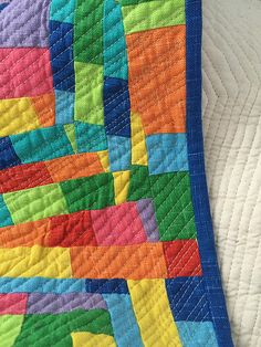 Made with strips of mixed fabrics in a log cabin method - posted on cauchycomplete.wordpress.com