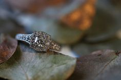 Full of character and ambiance. This platinum art deco inspired engagement ring with the shaped halo is making heads turn. By www.marionrehwinkeljewellery.com