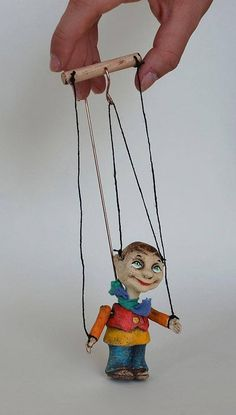 The pocket home elves can protect your home or follow you on your travels and bring you luck. Itll make an original gift for your friends or for your loved ones. Operating device: wire and strings Puppet weight: 100 g / 0.25 lb Height: 2,5 in Height of puppet with controller: 9 in Material: Clay Clay puppets are a good compromise of gypsum and wooden ones. Their price is more friendly than that of the wooden ones and the material is much stronger than gypsum. They are not heavy bec...
