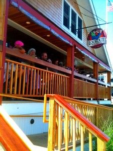 The Lookout Tavern.  A nice spot to eat lunch with a water view.  Across from the Ferry dock in Oak Bluffs http://www.lookoutmv.com/