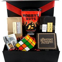 "This ""men only"" gift box hamper comes filled with luxury sweet treats and nuts, playing cards and a great puzzle game. Perfect gift for a man who likes to play games and enjoys sweet treats. Great unique gift on many occasions"