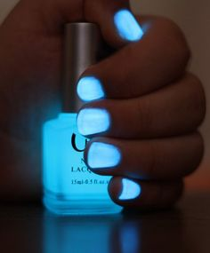 Break a glow stick and put in clear nail polish.. AWESOME.