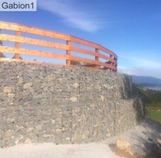 curved gabion retaining wall with timber post and rail fence http://www.gabion1.com