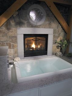 The only problem with this bathtub/fireplace combo is that I might never leave...