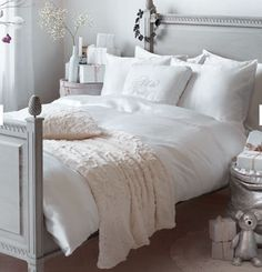 Grey painted wooden bed with lace blanket, touch of champagne. pretty!
