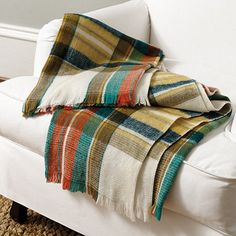 Our favorite seasonal colors in one cozy throw. Hand woven of cheek-soft 100% acrylic.