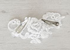 Romantic bridal lace hair accessory (lace hair clip) is handcrafted from white lace and stitched with pearls and crystals. The delicate vintage style design it's a beautiful addition to your classic or modern wedding. Vintage style wedding accessory will add retro glamour to your special occasion.  Features: • Bridal floral hair accessory with the hint of vintage • White lace • Delicate romantic floral design • Whole fascinator measures approx. 2.7 x 3.5 inches or 7x9 cm (measured at widest…