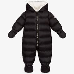 Black snowsuit for little boys and girls by French luxury brand Moncler Enfant, with detachable mittens and booties. Made in smooth nylon, with a water repellent coating and lined in soft jersey, it has soft down padding for superior comfort and warmth. There is a branded zip fastening down the front and a white rubberised logo badge on one sleeve. Moncler, French Luxury Brands, Snow Wear, Ski Girl, Waterproof Rain Jacket, Baby Coat, Little Boy And Girl, Black Down, Denim Coat