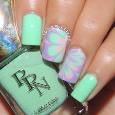 Beautiful #watermarble nail art with mint and lilac colors ===== Check out my Etsy store for some nail art supplies https://www.etsy.com/shop/LaPalomaBoutique